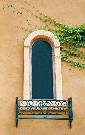 Vintage window on orange wall background photo