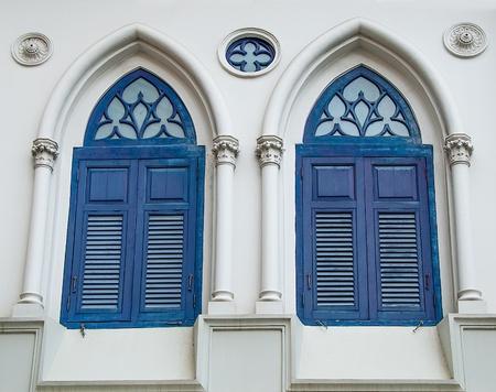 Ancient of twin wood window photo