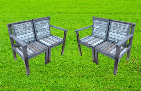 Old wooden bench on lawn photo