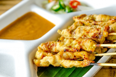 Grilled pork served with peanut sauce or sweet and sour sauce( moo satay) photo