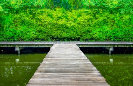 Wooden bridge across  canal photo