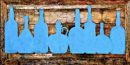 Sign bottle of liquor on wood photo