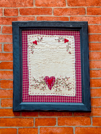 Old wooden frame on brickwall photo