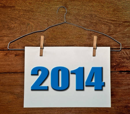 paper hanger: Hanger of white paper 2014 on wood background