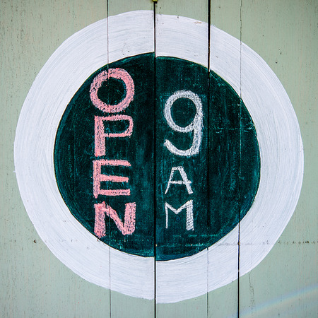 shop opening hours: Sketch of sign open 9 am on wood