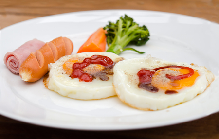 Fried egg with sausage and ham photo