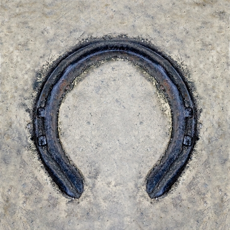 Rusted horseshoe on floor background photo