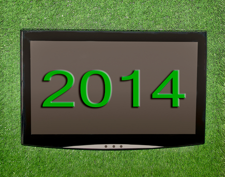 Lcd screen on artificial green grass of 2014 photo