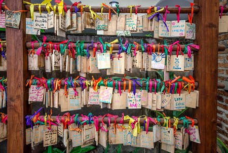 happieness: Mae hong sont, Thailand - 19 Dec: Wooden prayer tablets at Mae hong sont on 19 Dec 2013.  Pray for happieness good life healthy peace luck by write praying word in wooden tablet.