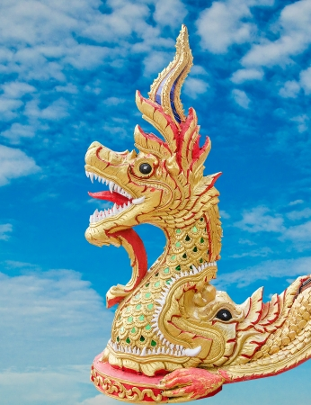 Carving Naga status on blue sky background photo