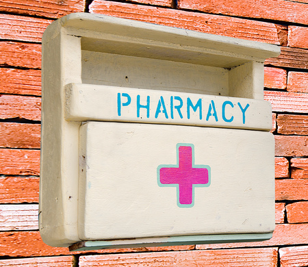 Medicine wooden cabinet isolated on wall background photo