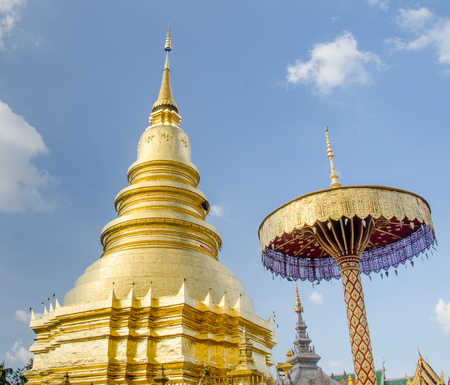 Golden pagoda in Temple of Lumpoon province, Thailand photo