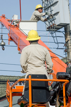 cope: Minburi, Thailand- Nov 9:Electrician are installing high powered electric cables to cope with the increasing power usage of cities surrounding Bangkok.  in minburi Thailand on Nov 9,2013