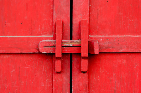 Closeup lock of red wooden door photo