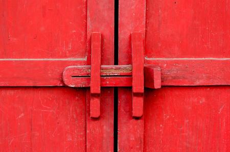 Closeup lock of red wooden door