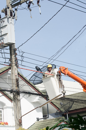 high powered: Minburi, Thailand- Nov 9:Electrician installing high powered electric cables to cope with the increasing power usage of cities surrounding Bangkok. in minburi Thailand on Nov 9,2013 Editorial