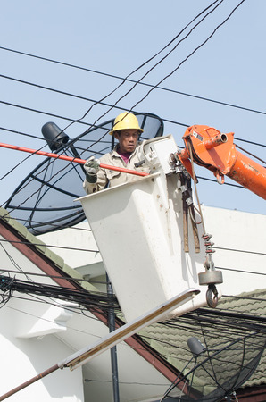 cope: Minburi, Thailand- Nov 9:Electrician installing high powered electric cables to cope with the increasing power usage of cities surrounding Bangkok. in minburi Thailand on Nov 9,2013 Editorial