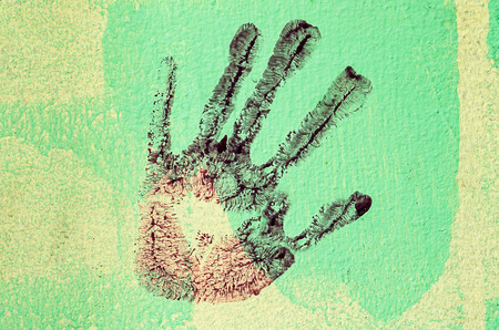 My hand print on wall background photo