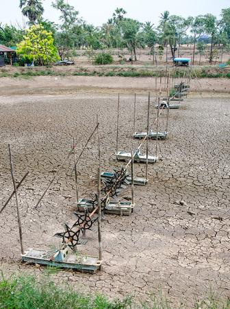 Aerator turbine wheel fill oxygen into shrimp pond photo