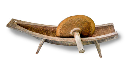 Old wooden mortar and pestle isolated on white background photo