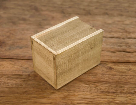 dura: Wooden box on table wood