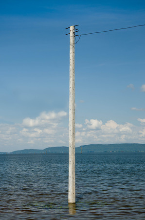 cement pole: Cement pole on dam in thailand Stock Photo