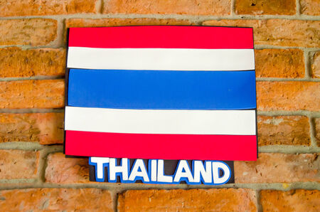 Sighburi,Thailand - OCT 19: Symbol Thailand National Flag on Wall in Robot museum on October 19,2014 in Sighburi province,Thailand