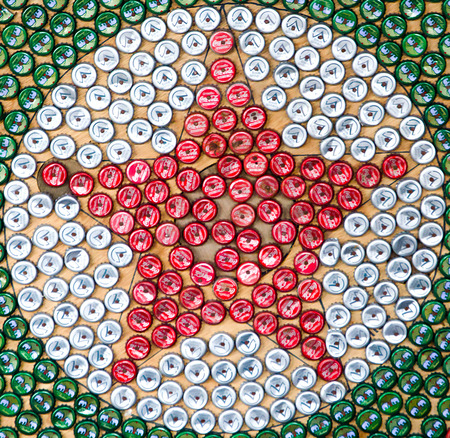Signburi, Thailand - October 19, 2014: Art of star group of bottle caps. The caps include both of beverage and beer. photo