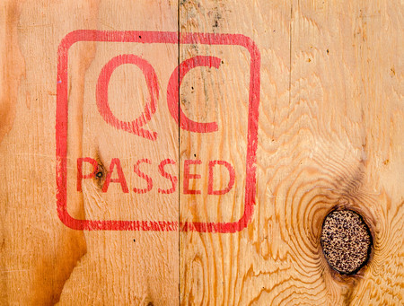 passed stamp: Stamp QC PASSED on wood background Stock Photo
