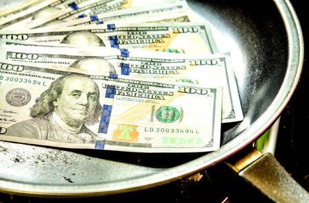 one hundred dollar bill: Stack of one hundred dollar bill on pan.