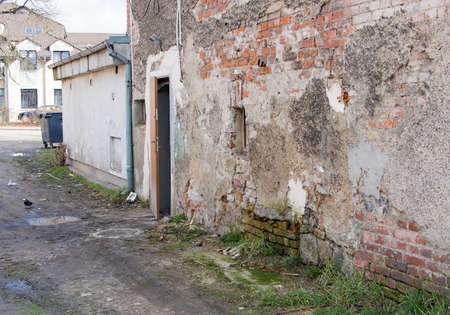 ruinous: ruinous old wall, open door, Jelenia Gora, Poland Stock Photo