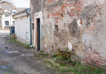 squalid: ruinous old wall, open door, Jelenia Gora, Poland Stock Photo