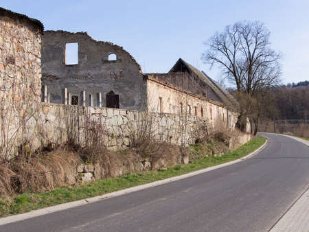 ruinous: Road beside a medieval wall and a ruinous building, Siedlecin, Poland Stock Photo