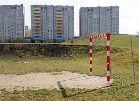 industrialized: soccer field in front of an industrialized apartment block, Jelenia Gora, Poland Editorial
