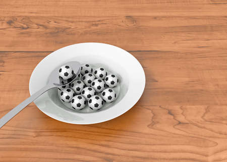 food plate: Soccer food - balls on a deep plate on wood, 3d illustration Stock Photo