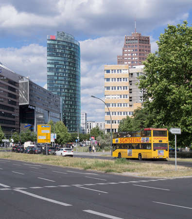 platz: BERLIN, GERMANY - JULY 7, 2016: Sightseeing bus in front of the towers at Potsdamer Platz in Berlin, Germany Editorial