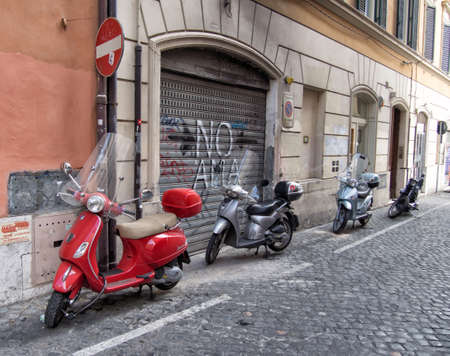 cobbled: ROME, ITALY - AUGUST 1, 2015: motorcycles in a cobbled street