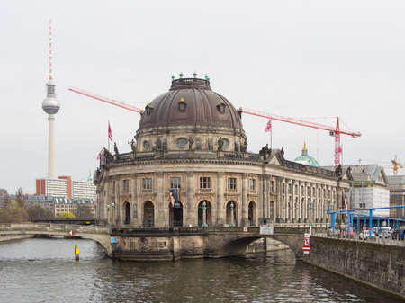 bode: BERLIN, GERMANY - JUNE 29, 2016: famous Bode Museum with Berlin TV Tower in background, Berlin, Germany Editorial