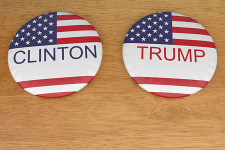 presidential election: BERLIN, GERMANY - AUGUST 9, 2016:US Presidential Election 2016: Clinton And Trump Badges On Wood, 3d illustration Editorial