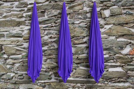 towels wall: Three Blue Hand Towels On A Medieval Wall, 3d illustration Stock Photo