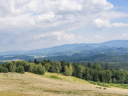 hilly: Beautiful hilly landscape with field and forest in Jelenia Gora, Poland Stock Photo