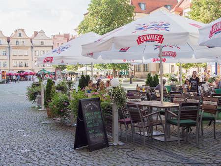 gora: JELENIA GORA, POLAND - AUGUST 13, 2016: Tourists At A Cafe At Townhall Square in Jelenia Gora, Poland Editorial