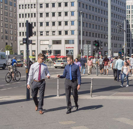 platz: BERLIN, GERMANY - AUGUST 25, 2016: Business Men And Tourists At Potsdamer Platz, Berlin Germany Editorial