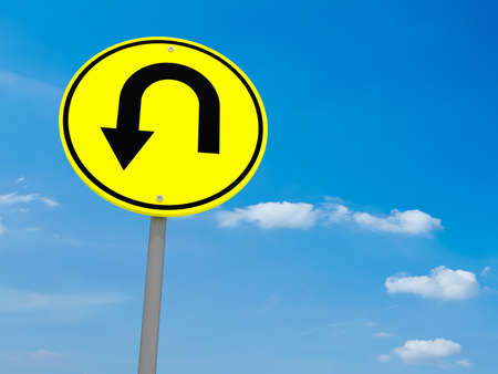 uturn: Round Yellow Road Sign U-Turn Against A Cloudy Sky, 3d illustration Stock Photo