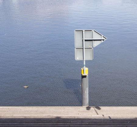 BERLIN, GERMANY - JUNE 21, 2017: Sign Post At The Water In Tempelhofer Hafen, Meaning Harbor of Tempelhof In German Language, In Berlin