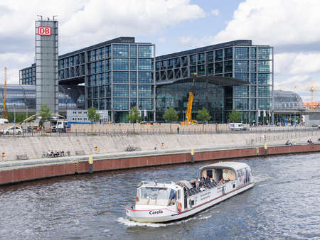 BERLIN, GERMANY - JUNE 26, 2017: Berlin Hauptbahnhof, Meaning Berlin Central Station In German Language, With River Spree With A Boat