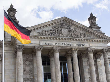 BERLIN, GERMANY - JUNE 26, 2017: Germany Politics Concept: German Flag In Front of The Reichstag Building