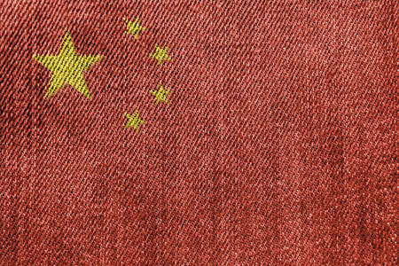 China Textile Industry Or Politics Concept: Chinese Flag Denim Jeans Background Texture