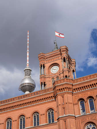 BERLIN, GERMANY - OCTOBER 8, 2017: Famous Rotes Rathaus, Meaning Red City Hall In German Language, With TV Tower In The Background In Berlin