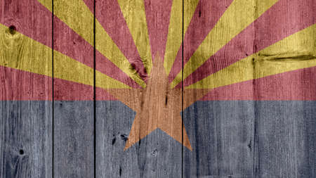 USA Politics News Concept: US State Arizona Flag Wooden Fence